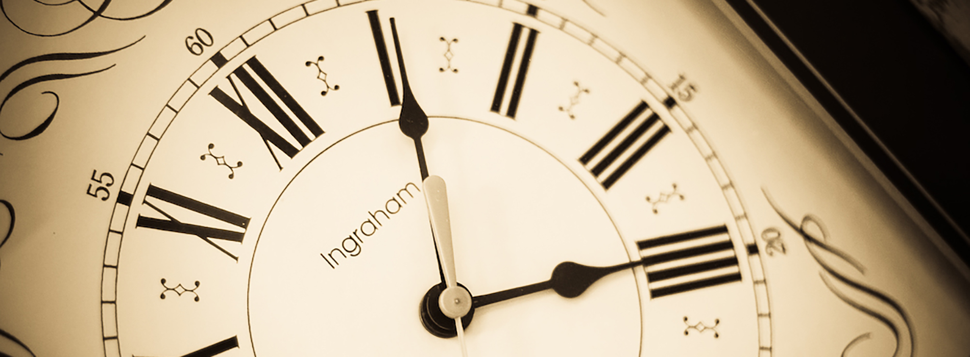 Antique clock face. The clock is ticking. There's no time like the present.