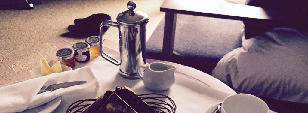 Elegant sufficiency - a coffee pot, brown toast and jam.