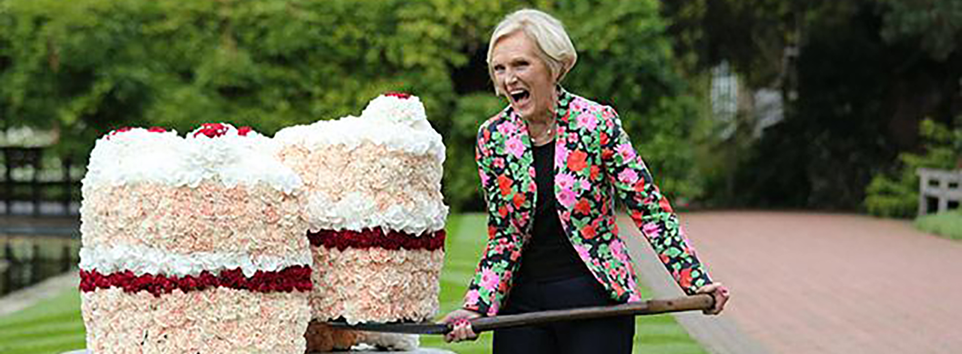 Mary berry and a huge slice of cake
