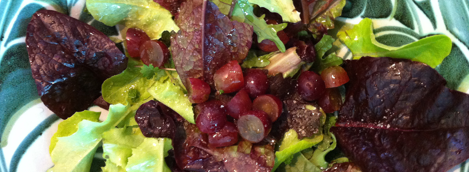 A nice fresh mixed leaf salad with red grapes.