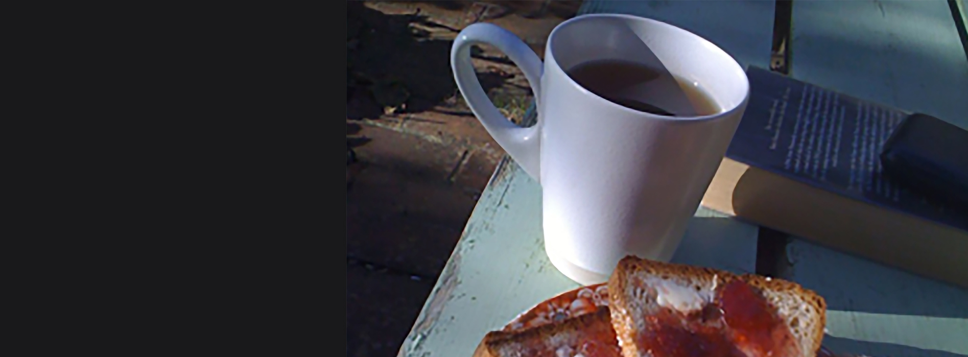 One slice of wholemeal bread, jam and a cup of tea