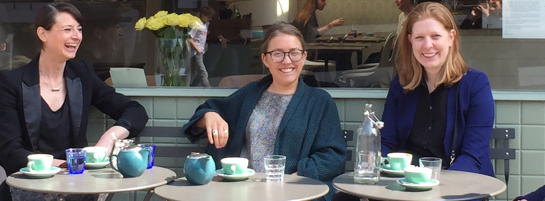 Image of three women enjoying a cup of coffee in a pavement cafe.